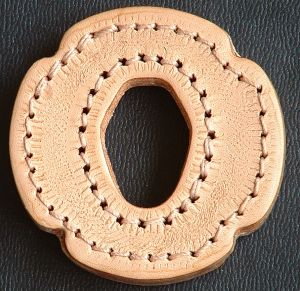 Machine stitched leather tsuba, front view